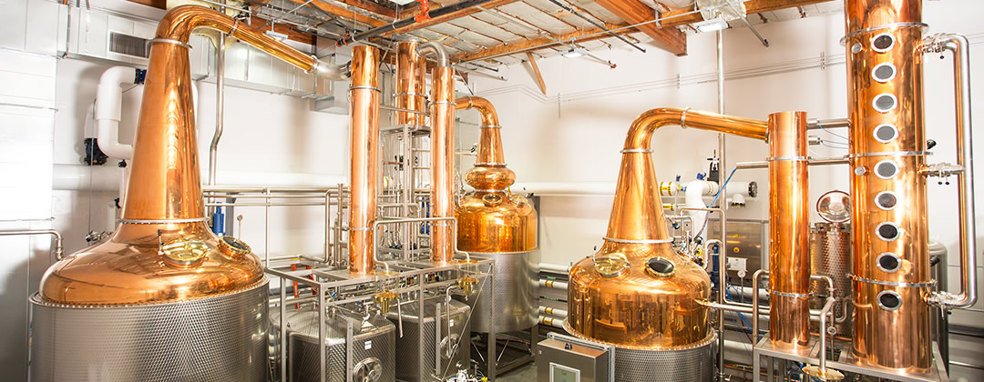 A view of the main section of the loch & union distillery in Napa Valley, California